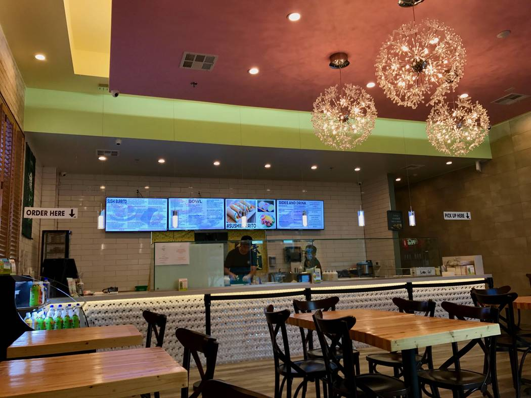 California Sushi Burrito's interior is pictured, with pastel paint accents and nautical decorations. Owner Juno Sul said he wants to give customers a sense of Southern California when they visit.  ...