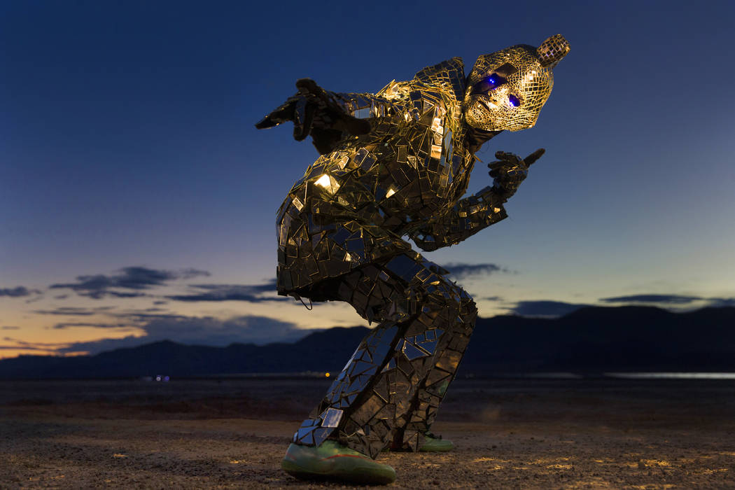 """Burner Steve MacWithey, aka """"Man in the Mirror,"""" hand made his famous glass suit containing over 5000 mirrored pieces. """"The suite allows people to see themselves and the energy they're giving off  ..."""