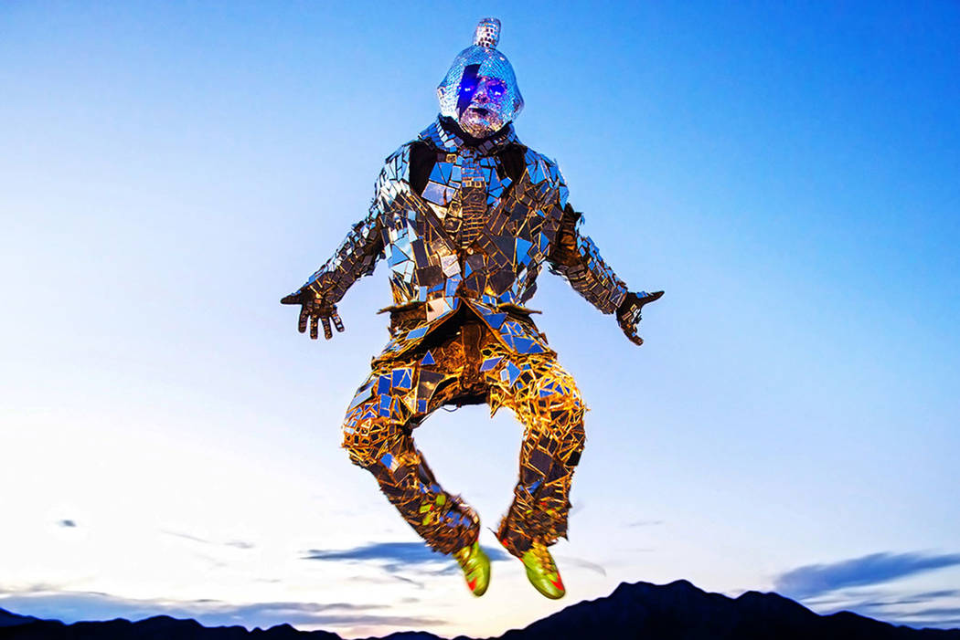 """Burner Steve MacWithey, aka """"Man in the Mirror,"""" hand made his famous glass suite containing over 5000 mirrored pieces. """"The suite allows people to see themselves and th ..."""