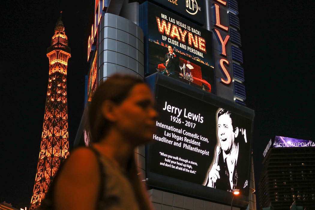 Legendary entertainer and humanitarian Jerry Lewis is honored on the Bally's and other marquees on the Strip Aug. 21, 2017, in Las Vegas. The 11-minute video tribute started at 19:49 military time ...