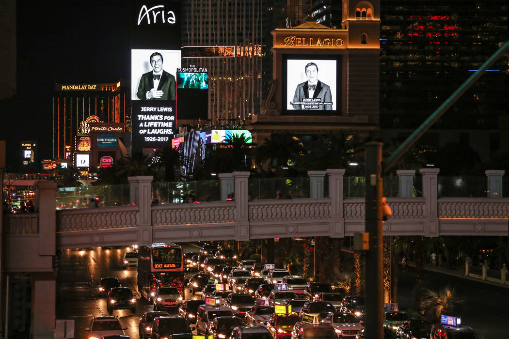 Legendary entertainer and humanitarian Jerry Lewis is honored on marquees on the Strip Aug. 21, 2017, in Las Vegas. The 11-minute video tribute started at 19:49 military time to mark the date Lewi ...