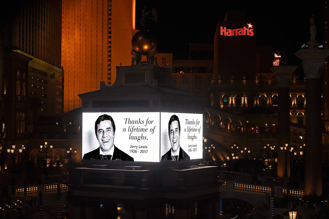 The marquee at The Venetian displays an image of legendary comedian, entertainer and humanitarian, Jerry Lewis Monday, Aug. 21, 2017, in Las Vegas. Resort properties and businesses throughout the  ...