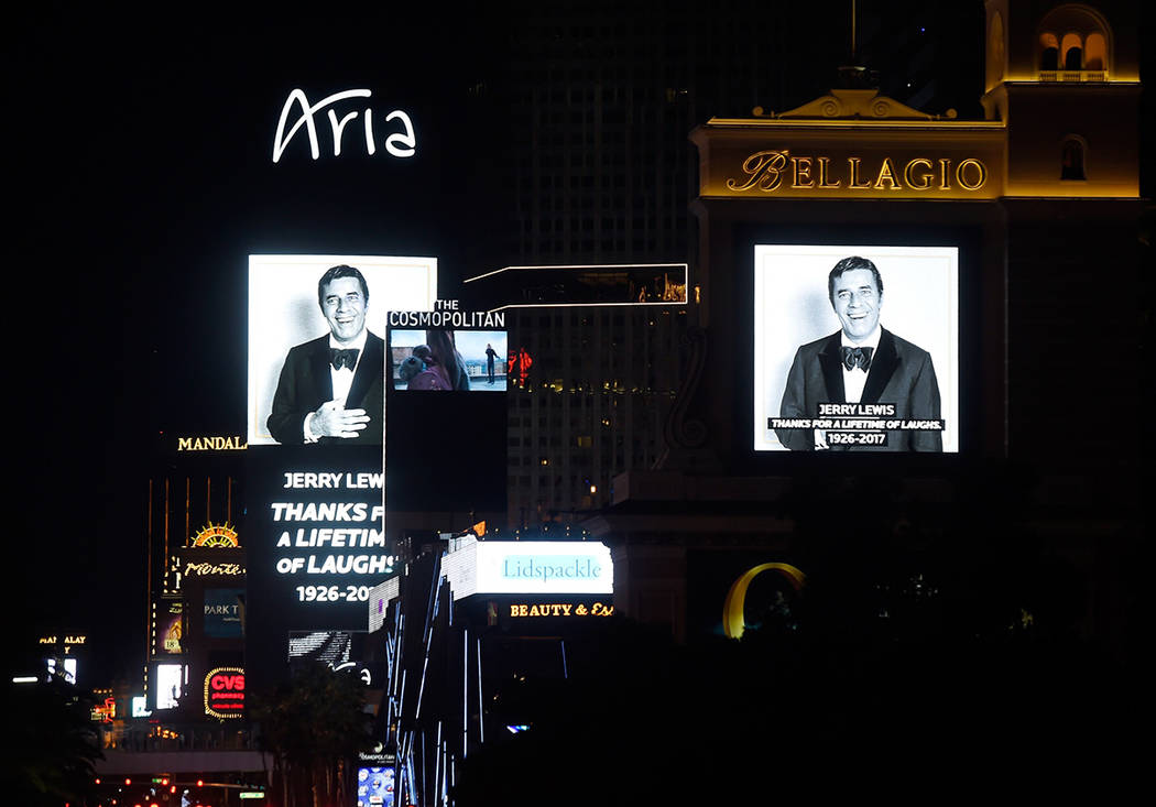 The marquee at several casinos display images of legendary comedian, entertainer and humanitarian, Jerry Lewis Monday, Aug. 21, 2017, in Las Vegas. Resort properties and businesses throughout the  ...