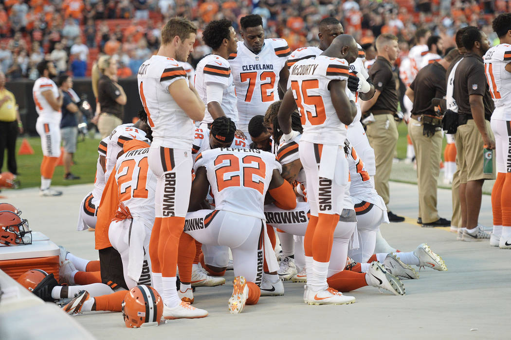 Aug 21, 2017; Cleveland, OH, USA; Members of the Cleveland Browns kneel during the national anthem before a game against the New York Giants at FirstEnergy Stadium. (Ken Blaze-USA TODAY Sports)