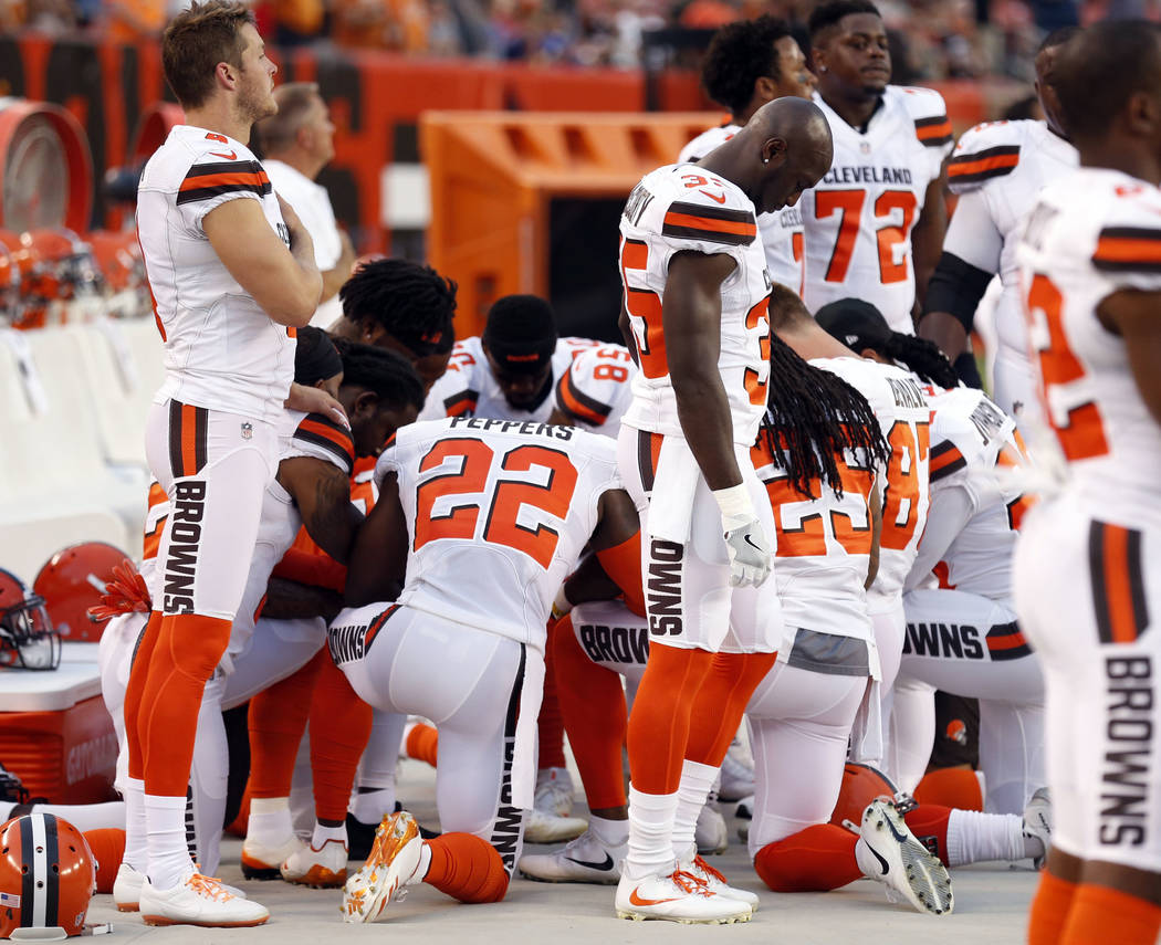 Members of the Cleveland Browns kneel during the national anthem before an NFL preseason football game between the New York Giants and the Cleveland Browns, Monday, Aug. 21, 2017, in Cleveland. (A ...