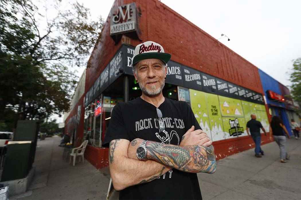 In this Sunday, Aug. 20, 2017, photo, Jim Norris poses for a photo outside of his information cafe called Mutiny in south Denver. Norris is hoping to license his storefront as one of the nation's  ...