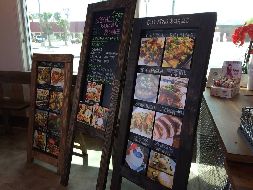 A menu board,  seen Aug. 21, 2017, helps patrons see menu highlights at Cutting Board Filipino Gastropub, 2131 Rock Springs Drive. (Jan Hogan/View)