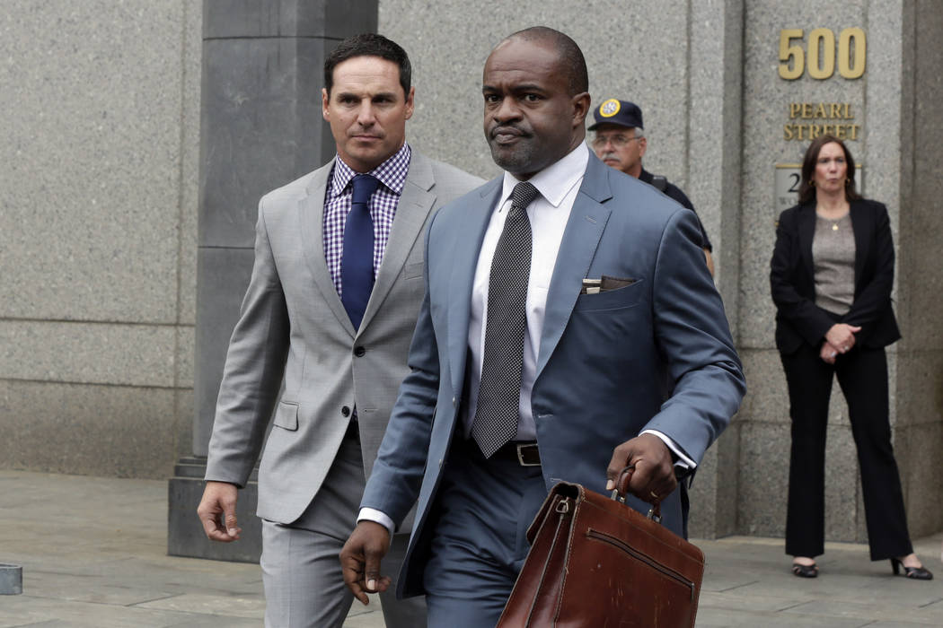 "NFL Players Association Player Advisory Council's Jay Feely, left, and NFLPA executive director DeMaurice Smith leave federal court following a hearing in the ""Deflategate"" case, ..."