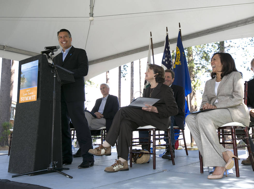 Nevada Gov. Brian Sandoval, left, speaks at the 21st Annual Lake Tahoe Summit, Tuesday, Aug. 22, 2017, in South Lake Tahoe, Calif. The summit is gathering of federal, state and local leaders to di ...