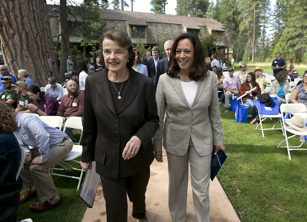 California's Democratic United States Senators, Dianne Feinstein, left, and Kamala Harris, walk together to speak at the 21st Annual Lake Tahoe Summit, Tuesday, Aug. 22, 2017, in South Lake Tahoe, ...
