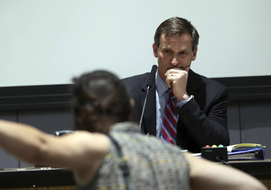 A protestors yells as Mayor Mike Signer listens during the Charlottesville City Council meeting Monday, Aug. 21, 2017, in Charlottesville, Va. Anger boiled over at the first Charlottesville City C ...