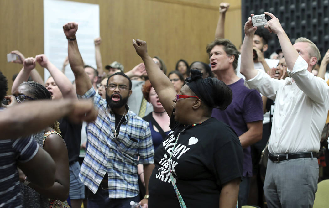 Protesters yell during the Charlottesville City Council meeting Monday, Aug. 21, 2017, in Charlottesville, Va. Anger boiled over at the first Charlottesville City Council meeting since a white nat ...