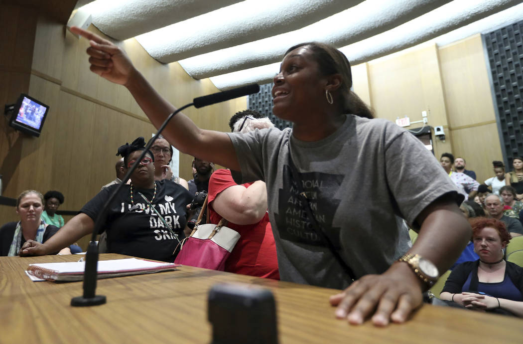 Tanesha Hudson addresses the Charlottesville City Council during a meeting Monday, Aug. 21, 2017, in Charlottesville, Va. Anger boiled over at the first Charlottesville City Council meeting since  ...