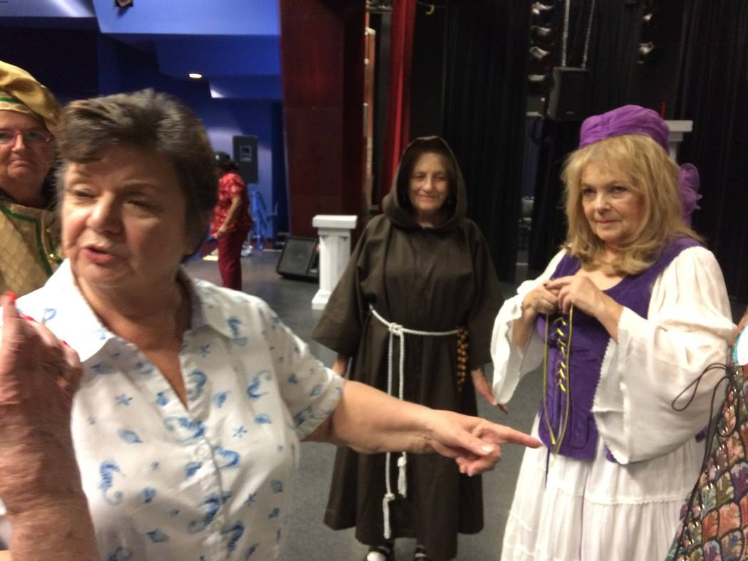 Director Cassie MacGuire gestures Aug. 8, 2017, as Adrienne Gentile tightens her corset laces during a dress rehearsal. The actors knew their lines but this day was about blocking out the scenes s ...