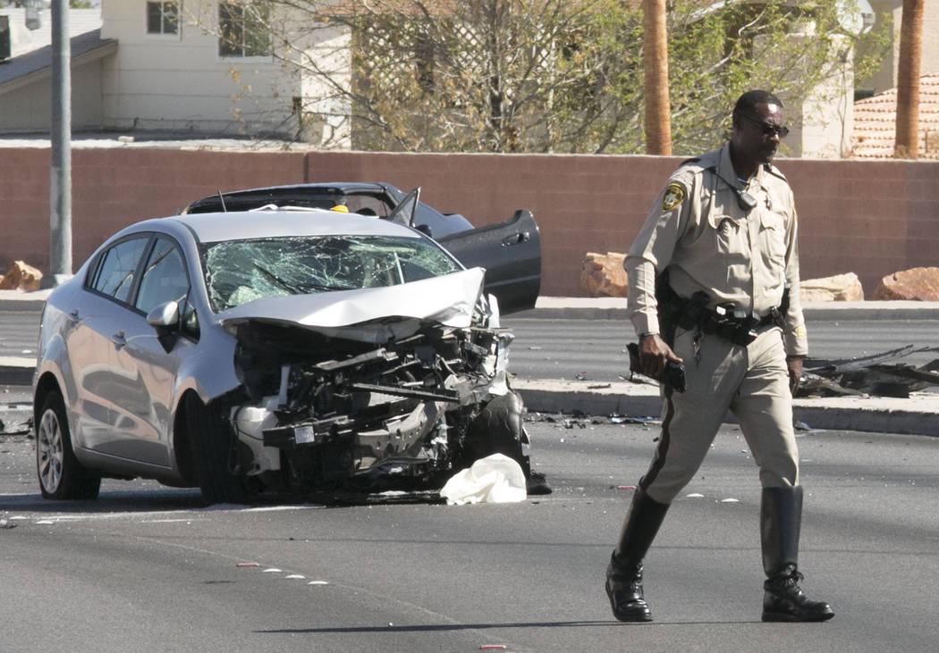 Metro investigates a fatal two-car crash at the intersection of Alta and South Buffalo drives Tuesday, Aug. 22, 2017, in Las Vegas. (Bizuayehu Tesfaye/Las Vegas Review-Journal) @bizutesfaye