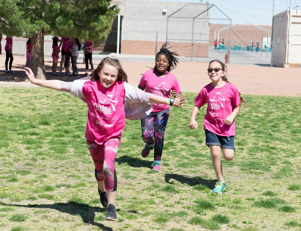 Girls complete a run at Bonner Elementary School in this photo from 2016. Girls On the Run is an after-school program that promotes self confidence and character development while offering a physi ...