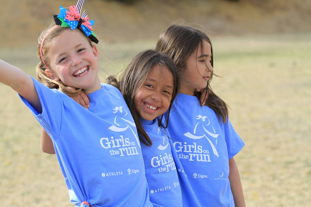 Girls celebrate during a Girls On the Run event in 2016. The after-school program presents real-life situations to help Las Vegas youngsters steer through various scenarios such as bullying at sch ...