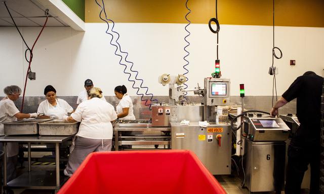 Employees at the Clark County Food Service Department prepare food in Las Vegas on Friday, Sept. 9, 2016. Miranda Alam/Las Vegas Review-Journal @miranda_alam