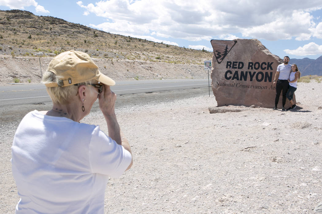 Visitor Sharon Weeks, left, takes a photo of granddaughter Margeaux Boudreaux and her boyfriend Samir Jasarevic, who are Las Vegas locals, at Red Rock Canyon National Conservation Area sing on Tue ...