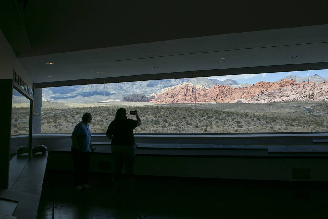 Visitors take photos from the visitors center at Red Rock Canyon National Conservation Area on Tuesday, Aug. 22, 2017, in Las Vegas. (Bridget Bennett/Las Vegas Review-Journal) @bridgetkbennett