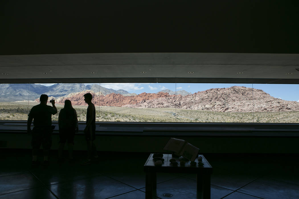 Visitors take photos at the Red Rock Canyon National Conservation Area's visitor center on Tuesday, Aug. 22, 2017, in Las Vegas. (Bridget Bennett/Las Vegas Review-Journal) @bridgetkbennett