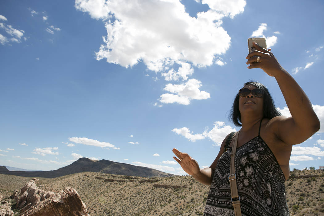 Visitor Lisa McCrury from Ohio, right, takes a photo at Red Rock Canyon National Conservation Area on Tuesday, Aug. 22, 2017, in Las Vegas. (Bridget Bennett/Las Vegas Review-Journal) @bridgetkbennett