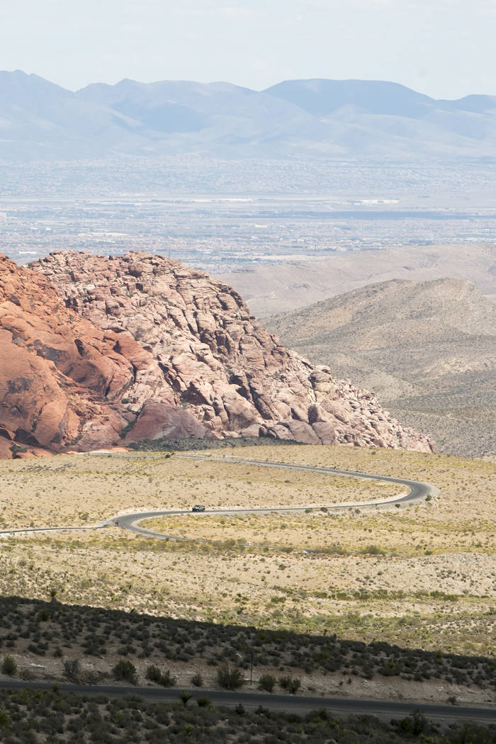 A car winds up the  scenic loop at Red Rock Canyon National Conservation Area on Tuesday, Aug. 22, 2017, in Las Vegas. (Bridget Bennett/Las Vegas Review-Journal) @bridgetkbennett