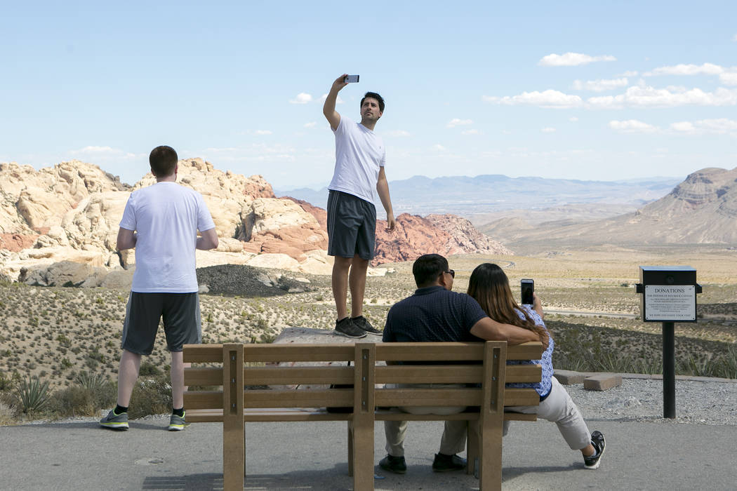 Visitor Niels Ebert from Germany, center, takes a photo at Red Rock Canyon National Conservation Area on Tuesday, Aug. 22, 2017, in Las Vegas. (Bridget Bennett/Las Vegas Review-Journal) @bridgetkb ...