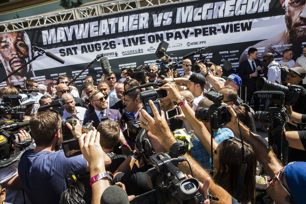 Conor McGregor addresses the media at Toshiba Plaza outside T-Mobile Arena in advance of his Saturday night fight with Floyd Mayweather Jr. Photo taken on Tuesday, Aug 22, 2017, in Las Vegas. Benj ...