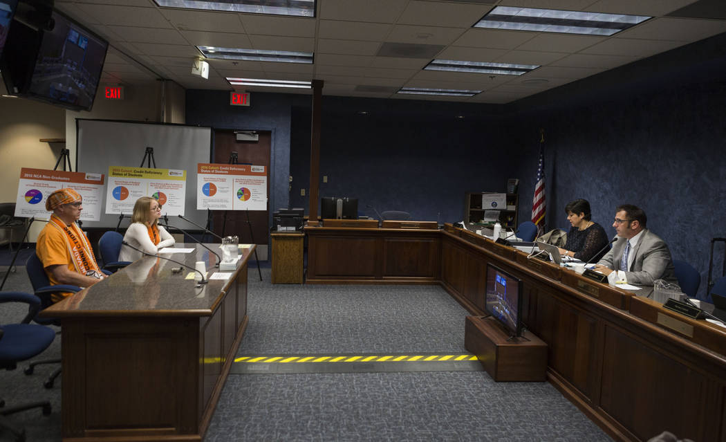 Frank Malley, left, and Cheyenne Malley, 13, from Nevada Connections Academy speak to the state public charter authority board in hopes to keep the school open during a meeting at the Grant Sawyer ...
