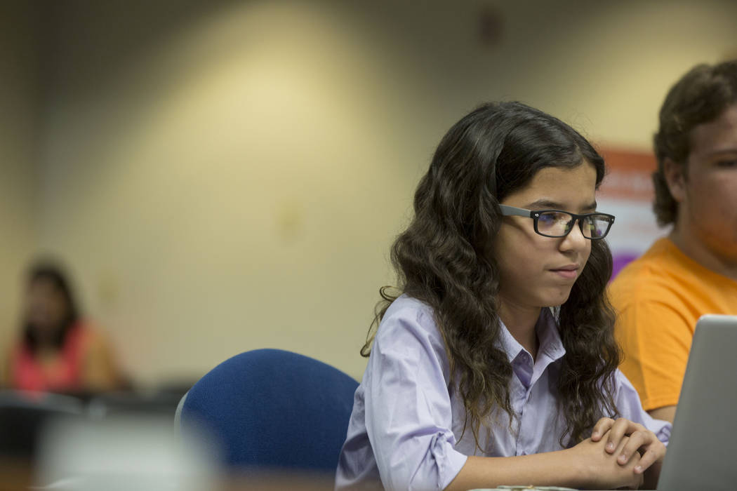 "Nevada Connections Academy student Naseem Benjelloun, 13, allows his ""personal assistant"" Frank, a computer that he has programed to speak for him, to defend why his school should remain open to t ..."