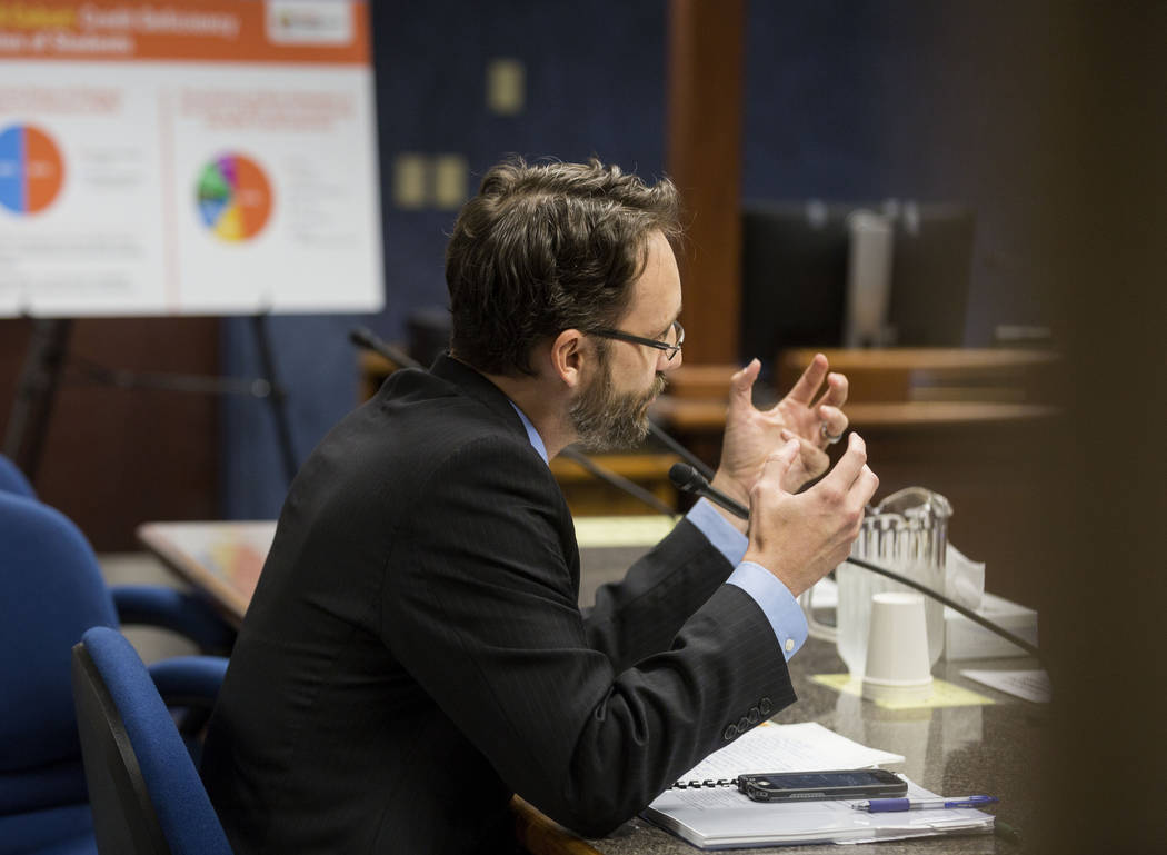 Deputy attorney general representing the state Public Charter School Authority Greg Ott speaks to the state public charter authority board regarding Nevada Connections Academy, at the Grant Sawyer ...