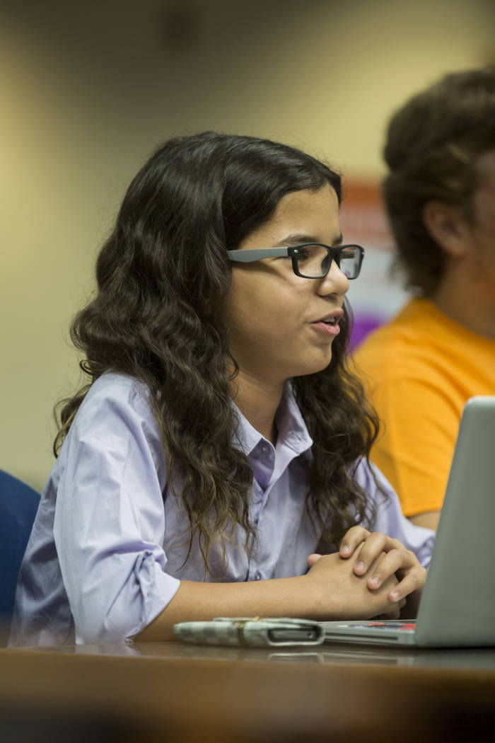 "Nevada Connections Academy student Naseem Benjelloun, 13, explains his ""personal assistant"" Frank, a computer that he has programed to speak for him, to defend why his school should remain open to ..."
