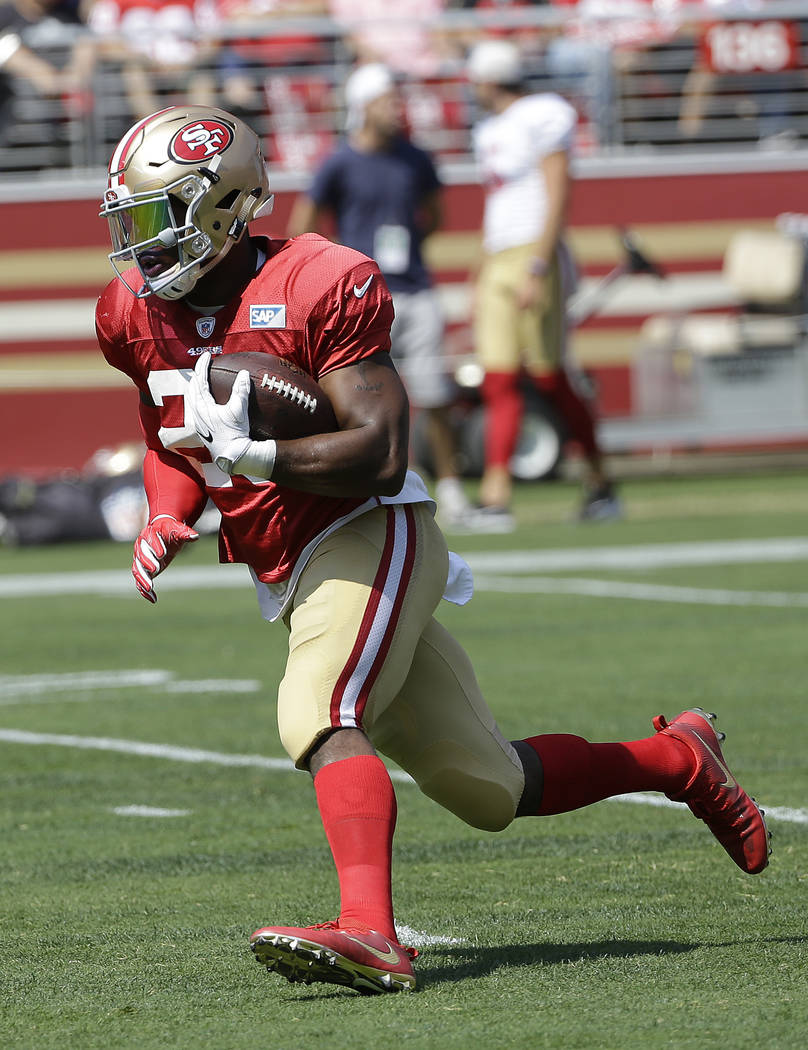 San Francisco 49ers' Carlos Hyde during an NFL football training camp in Santa Clara, Calif., Saturday, Aug. 5, 2017. (AP Photo/Jeff Chiu)