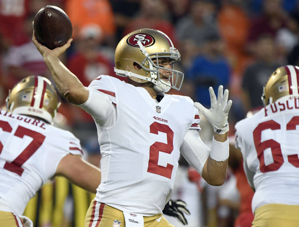 San Francisco 49ers quarterback Brian Hoyer (2) throws as center Daniel Kilgore (67) and offensive lineman Brandon Fusco (63) block during the first half of the team's NFL preseason football game  ...