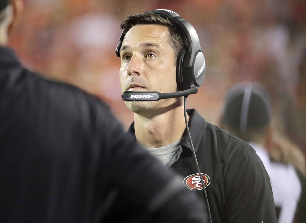 San Francisco 49ers coach Kyle Shanahan looks at the scoreboard during the first half of the team's NFL preseason football game against the Kansas City Chiefs in Kansas City, Mo., Friday, Aug. 11, ...