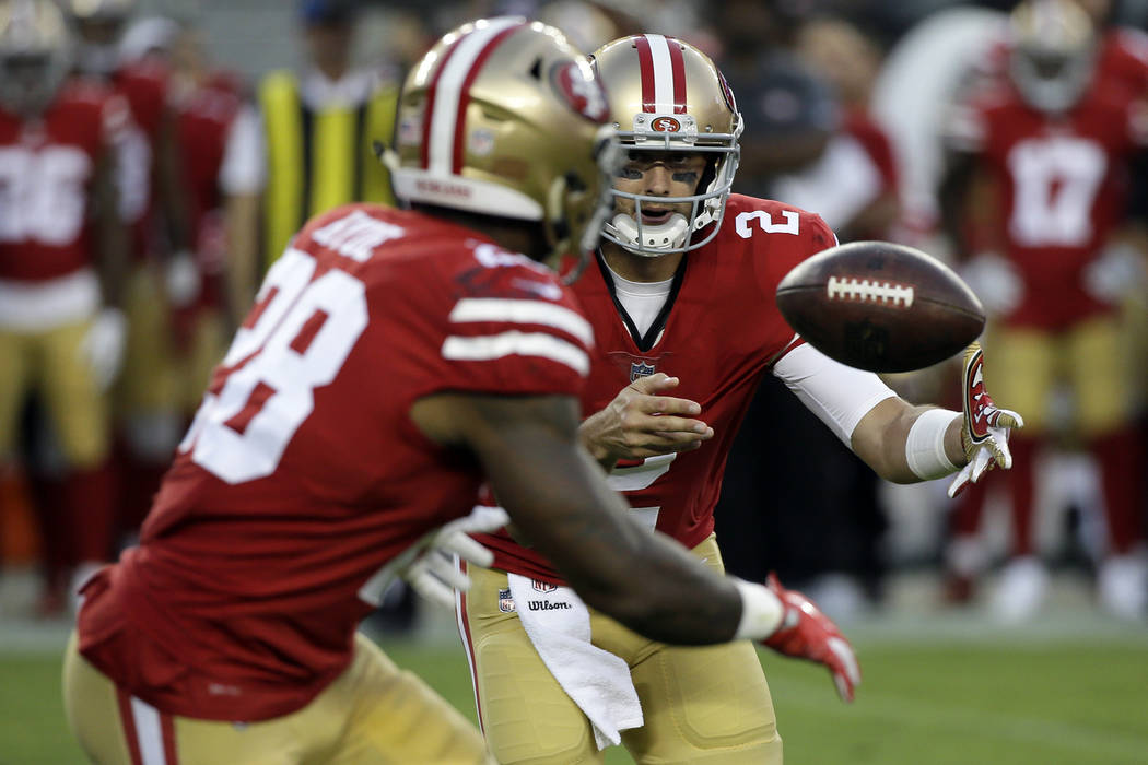 San Francisco 49ers quarterback Brian Hoyer (2) pitches to running back Carlos Hyde during the first half of a preseason NFL football game against the Denver Broncos Saturday, Aug. 19, 2017, in Sa ...