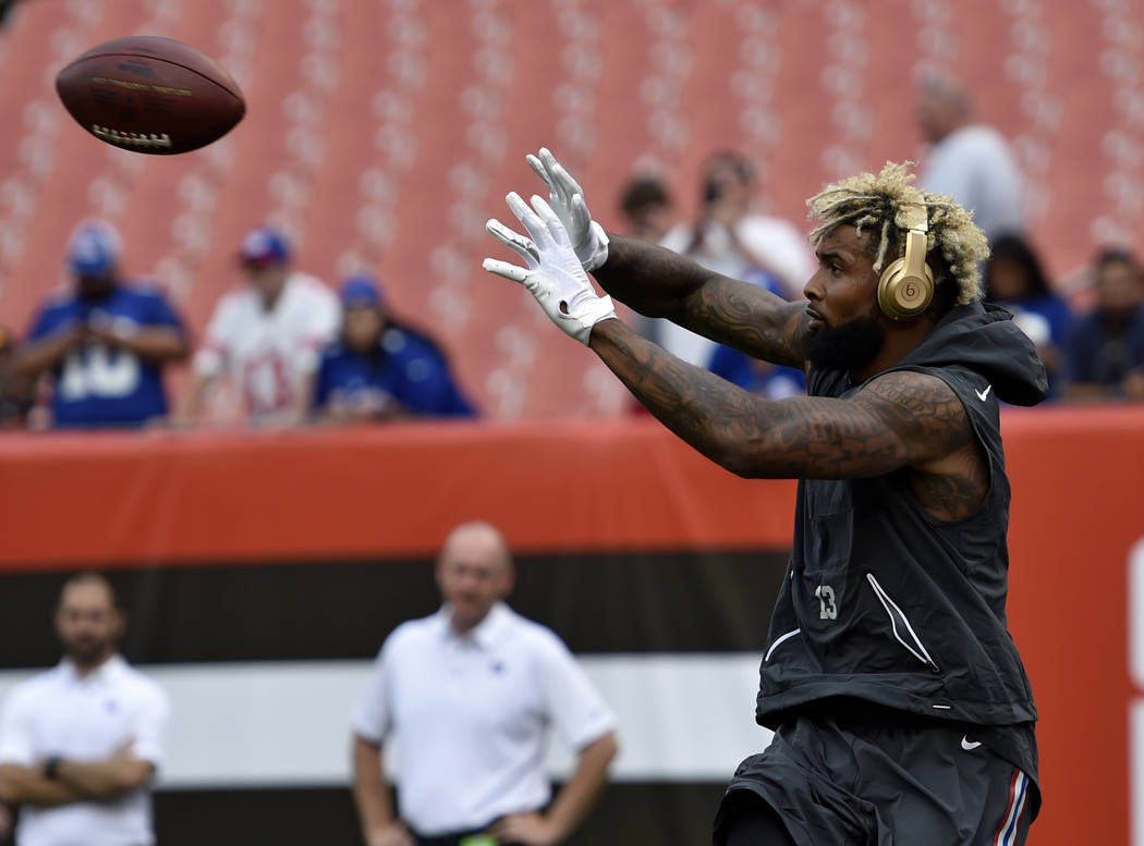 New York Giants wide receiver Odell Beckham catches a pass before an NFL football game between the New York Giants and the Cleveland Browns, Monday, Aug. 21, 2017, in Cleveland. (AP Photo/David Ri ...