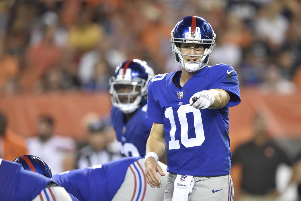 New York Giants quarterback Eli Manning (10) calls a play during an NFL preseason football game against the Cleveland Browns, Monday, Aug. 21, 2017, in Cleveland. The Browns won 10-6. (AP Photo/Da ...
