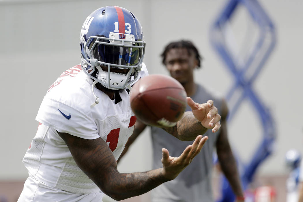 This Aug. 8, 2017, file photo shows New York Giants wide receiver Odell Beckham working out during NFL football training camp in East Rutherford, N.J. (AP Photo/Julio Cortez, File)