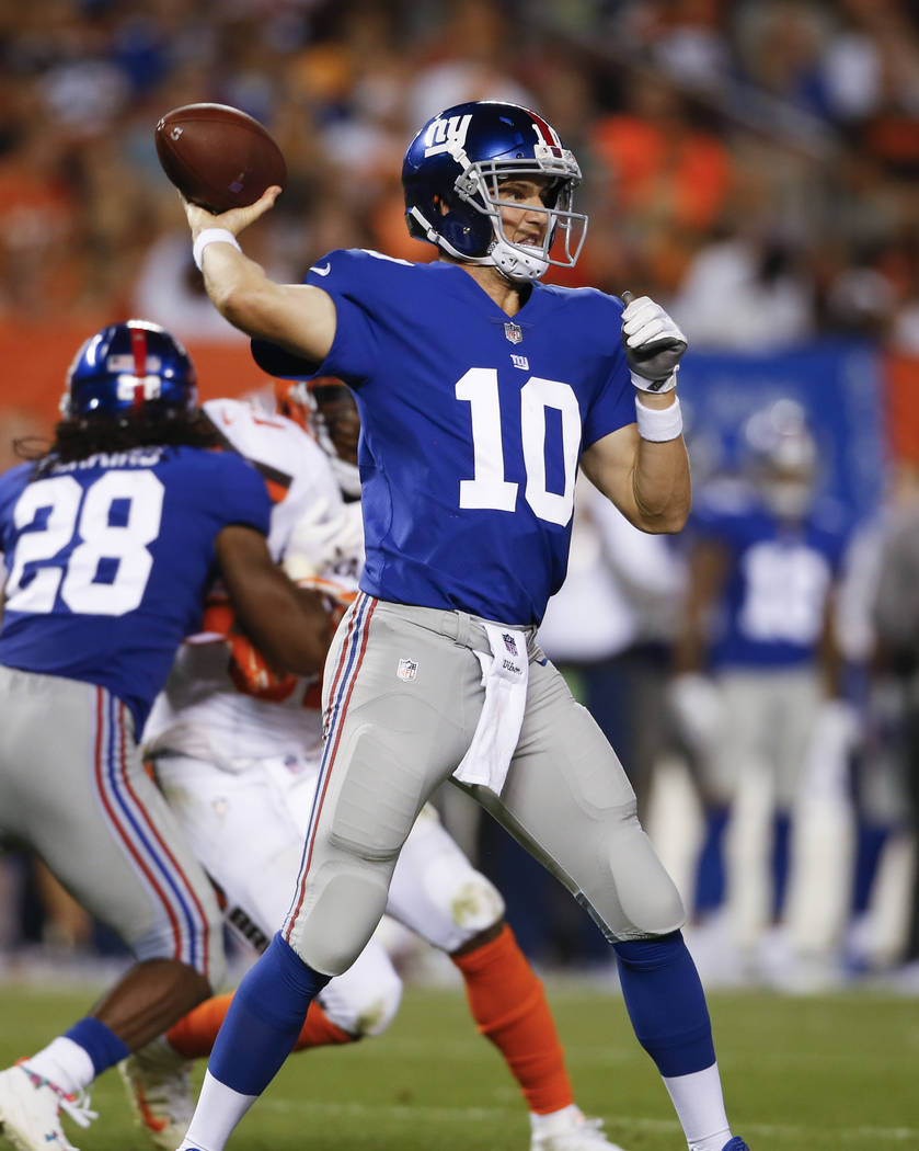 New York Giants quarterback Eli Manning (10) plays against the Cleveland Browns during the first half of an NFL preseason football game, Monday, Aug. 21, 2017, in Cleveland. (AP Photo/Ron Schwane)