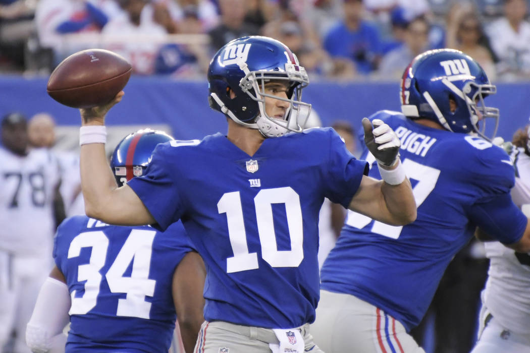 New York Giants quarterback Eli Manning (10) throws a pass during the first half of a preseason NFL football game against the New York Jets Saturday, Aug. 26, 2017, in East Rutherford, N.J. (AP Ph ...