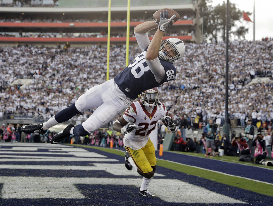 File-This Jan. 2, 2017, file photo shows Penn State tight end Mike Gesicki, top, catching a touchdown pass as Southern California defensive back Leon McQuay III looks on during the first half of t ...