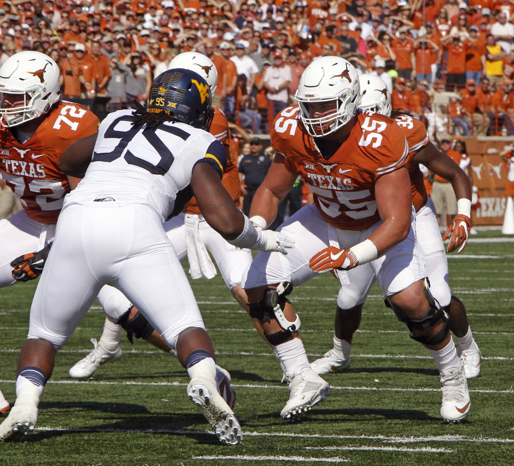 FILE - In this Nov. 12, 2016, file photo, Texas lineman Connor Williams (55) blocks against West Virginia lineman Christian Brown during the first half of an NCAA college football game, in Austin, ...