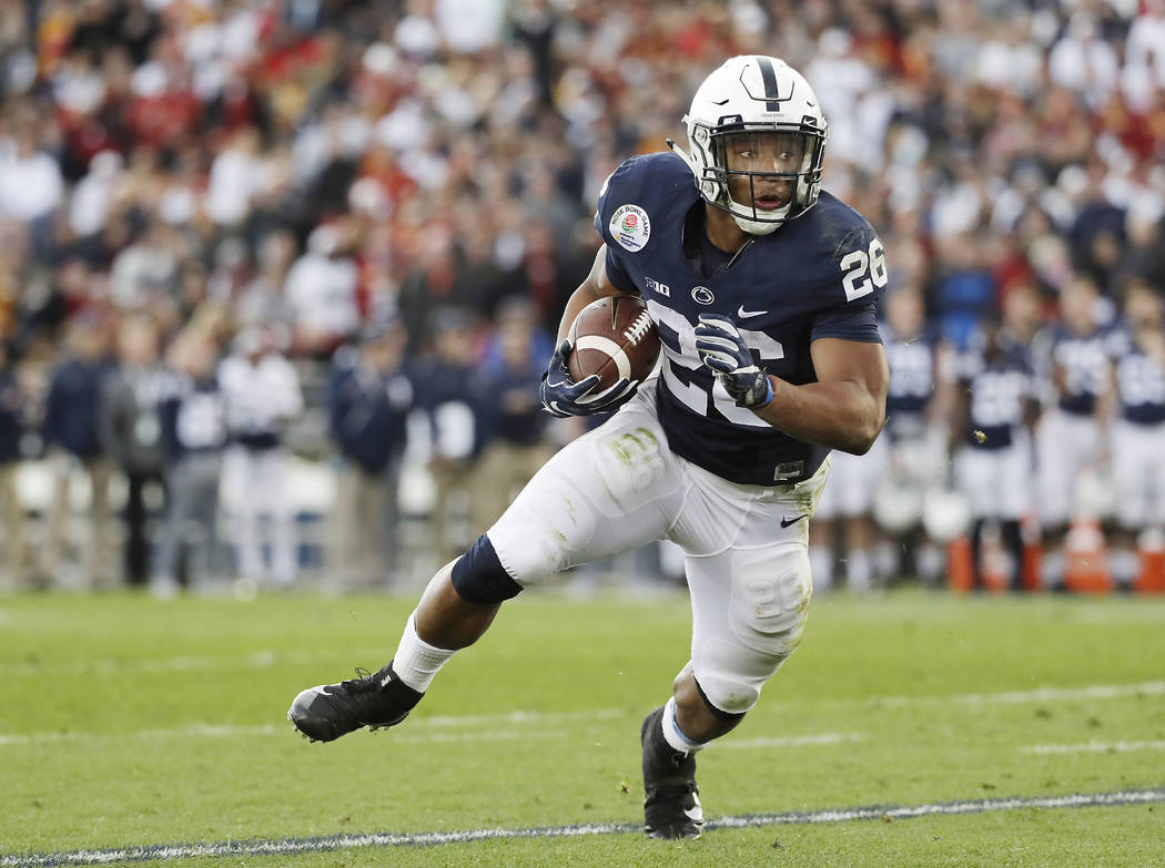File-This Jan. 2, 2017, file photo shows Penn State Nittany Lions running back Saquon Barkley looking for room to run against USC during the first half of the Rose Bowl NCAA college football game, ...