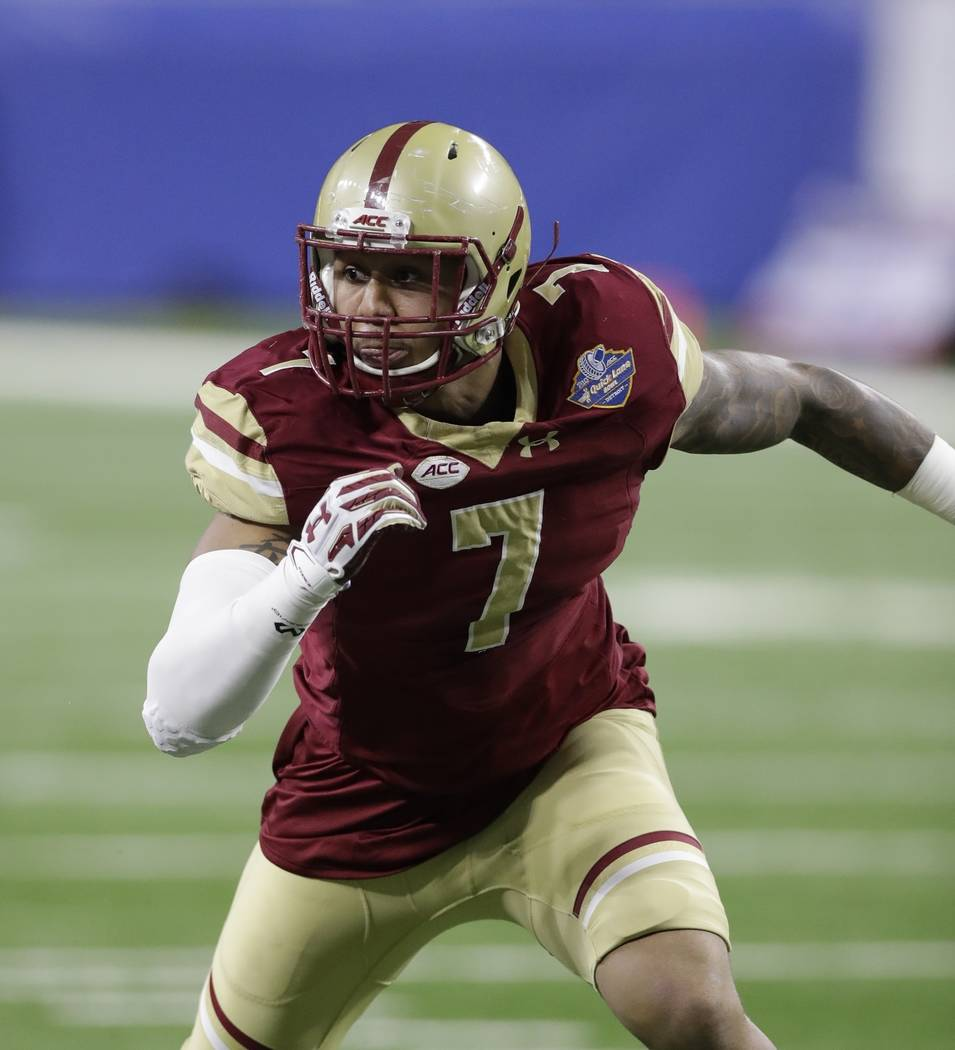 File-This Dec. 26, 2016, file photo shows Boston College defensive end Harold Landry rushes the line during the first half of the Quick Lane Bowl NCAA college football game in Detroit. Landry was  ...