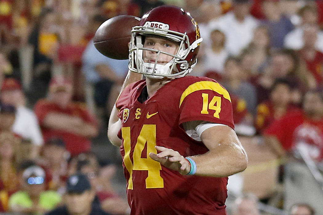 In this Oct. 1, 2016, file photo, Southern California quarterback Sam Darnold (14) throws a touchdown pass to wide receiver JuJu Smith-Schuster (9) during the first half of an NCAA college footbal ...