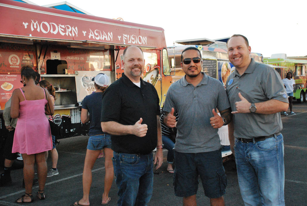 Findlay VW Food Truck Frenzy events at Findlay North Volkswagen have proven very popular at the dealership each Saturday from 5-8 p.m. Enjoying the event are , from left, dealership General Manage ...