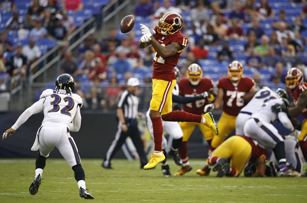 Washington Redskins wide receiver Terrelle Pryor (11) bobbles a pass attempt in front of Baltimore Ravens strong safety Eric Weddle in the first half of a preseason NFL football game, Thursday, Au ...