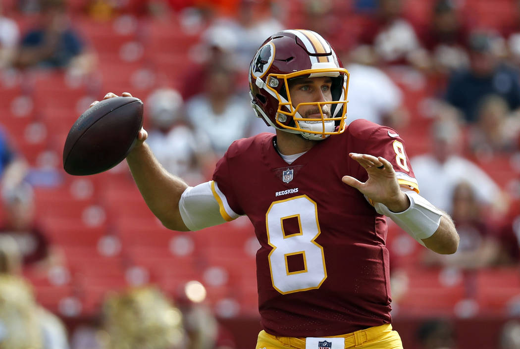 Washington Redskins quarterback Kirk Cousins throws to a receiver in the first half of a preseason NFL football game against the Cincinnati Bengals, Sunday, Aug. 27, 2017, in Landover, Md. (AP Pho ...